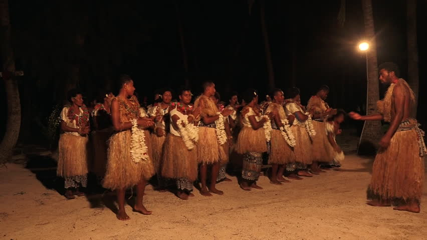 Indigenous Fijian people sing and dance a traditional Fijian dance. Real people copy space