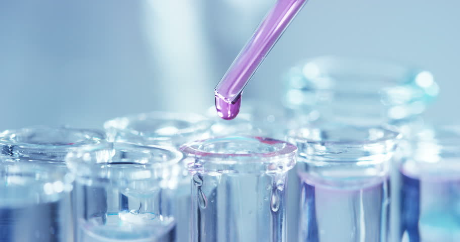 In a laboratory, a scientist with a pipette analyzes a colored liquid to extract the DNA and molecules in the test tubes. Concept: research, biochemistry, nature, pharmaceutical medicine | Shutterstock HD Video #24263978