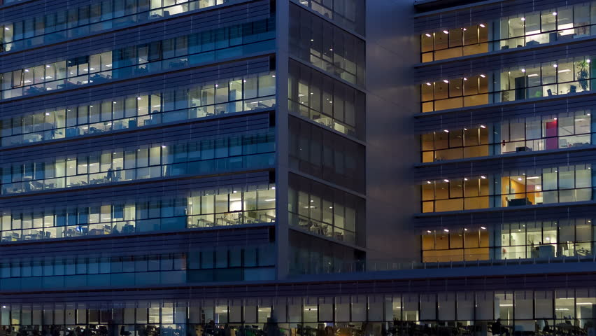 Office building, with illuminated interior at dusk, in the city of Barcelona. Panning Right. | Shutterstock HD Video #24266471