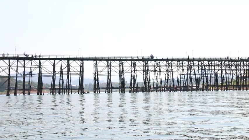 Old wooden bridge, classic collapse Bridge across the river and Wood bridge (Mon bridge) at Sangklaburi, kanchanaburi province romantic place in Asia thailand