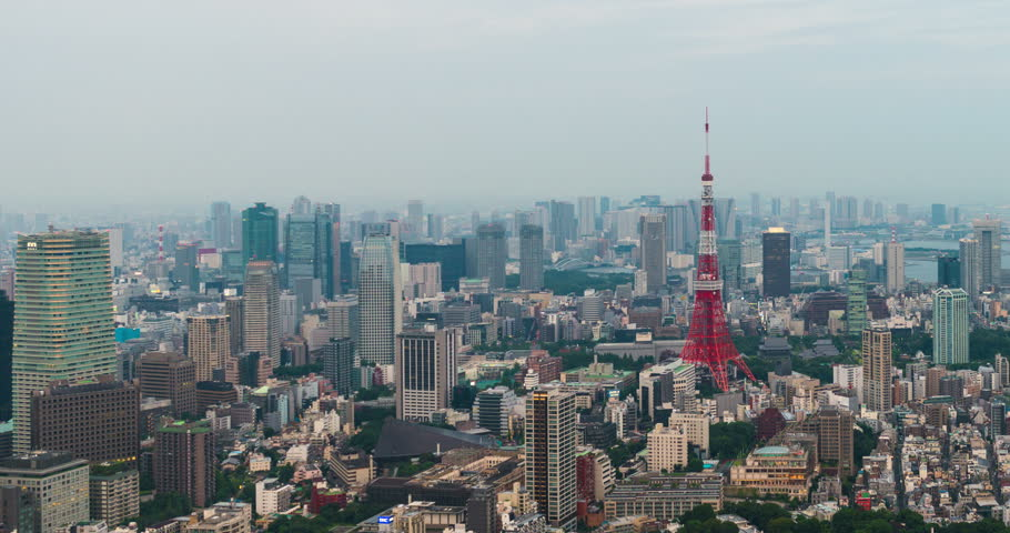 Tokyo, Japan - September 17, 2016: Time-lapse of Skyline with the Tokyo tower at sunset . Tokyo tower is a communications and observation tower located in the Shiba-koen district | Shutterstock HD Video #24303431