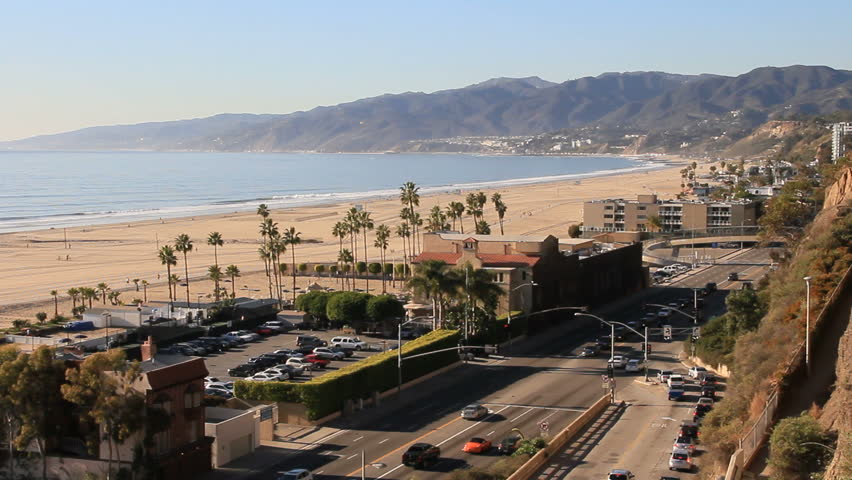 Pacific Coast Highway traffic in Santa Monica, CA. Traffic on pacific coax highway. Santa Monica, Malibu and ocean is in the background