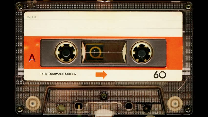 Audio cassette tape in use sound recording in the tape recorder. Vintage music cassette with a blank white label, playing back in the player. 4K, static camera shot  | Shutterstock HD Video #24315491