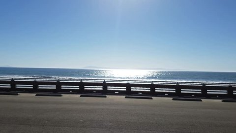 Driving on route highway 1, at the pacific sea coast near Los Angeles, in California, United states of america.