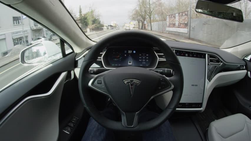 ljubljana slovenia february 4 2017 self driving tesla model s autopilot steering on urban. Black Bedroom Furniture Sets. Home Design Ideas