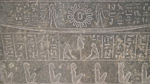 close up panning shot of engraved egyptian hieroglyphics on a stone coffin in cairo, egypt
