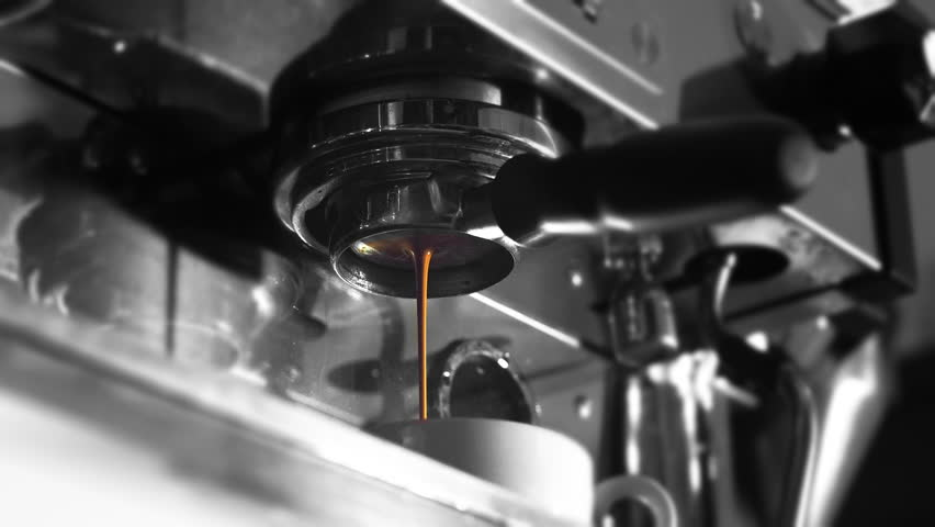 Professional coffee machine pouring espresso coffee with naked portafilter. Black and white, 4K video | Shutterstock HD Video #24374351