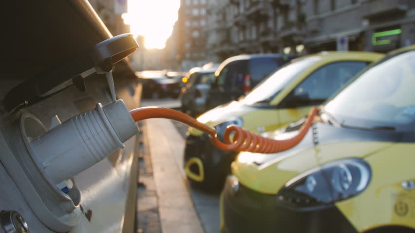 Small yellow electro cars is charging in the street station. Close-up.   Shutterstock HD Video #24378983