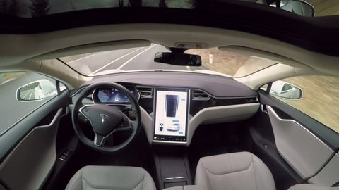 LINZ, AUSTRIA - FEBRUARY 2nd 2017: Fully autonomous self-driving Tesla Model S car with updated enhanced autopilot feature. Driverless vehicle with next gen ultrasonic sensors, cameras and radars