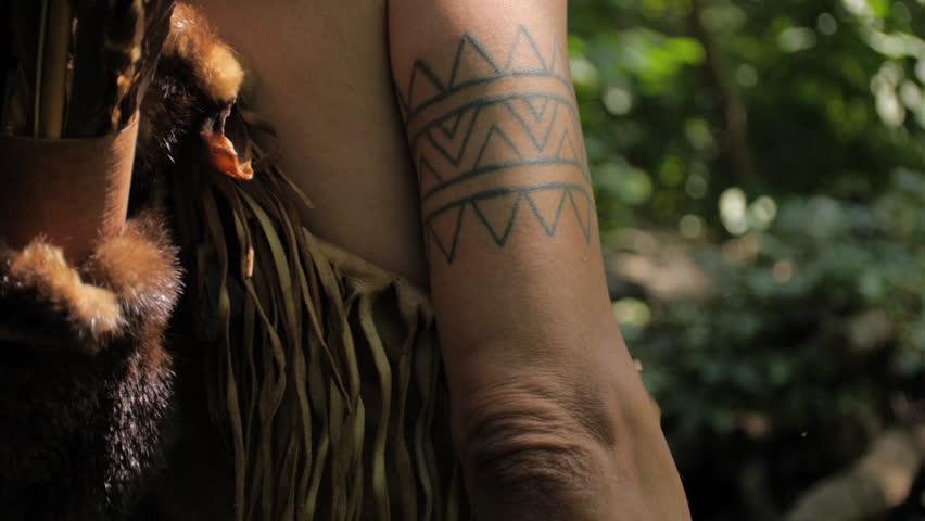 VIRGINIA - SUMMER 2015 - Reenactment, Recreation. Ancient -18th & 19th century, 1500s-1800s Native American, Eastern Woodland Indian Warrior, Powhatan hunting, warpath with bow & arrow.  Flint arrow.   Shutterstock HD Video #24403481