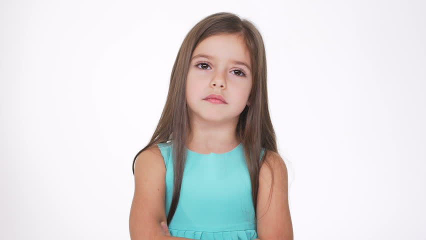 Displeased Pretty girl in turquoise dress with tears on eyes | Shutterstock HD Video #24471791