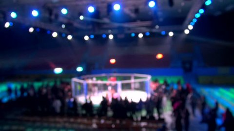 mma cage arena octagonal ring for fights. Mixed Martial arts fight. Light beams flashing spotlights. Blurred.