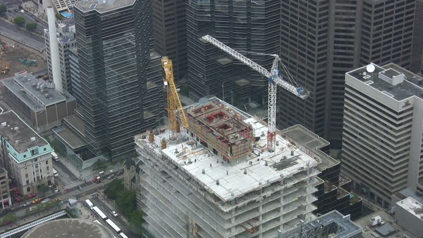 Timelapse shot of construction cranes. Downtown Toronto.