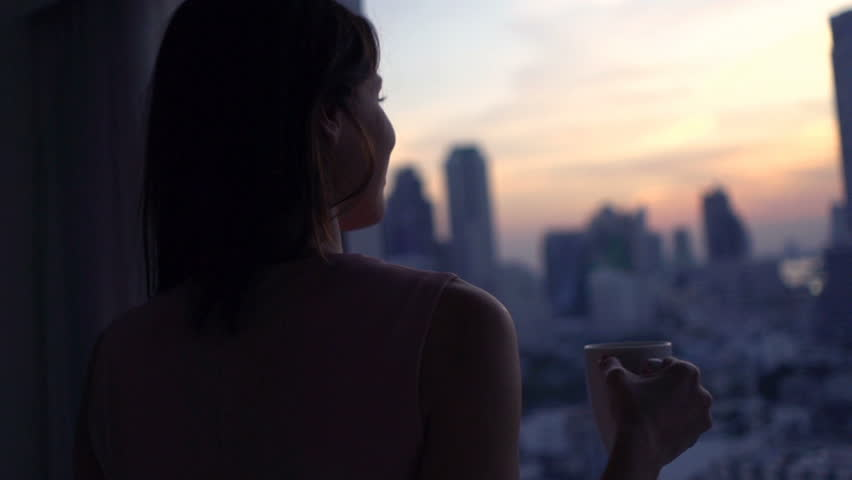 Happy woman with beverage admire view from window, super slow motion 240fps