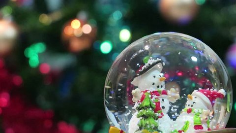 Christmas snow globe and abstract lighting background
