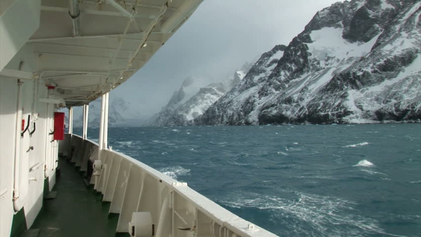 South Georgia and the South Sandwich Islands: expedition ship passing mountain.
