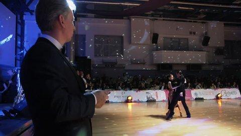 Poltava, Ukraine, Dec 2016 : A lot of couples dancing passionate Latin dance in the ballroom.