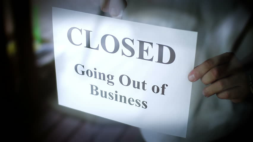 A CLOSED going out of business sign.