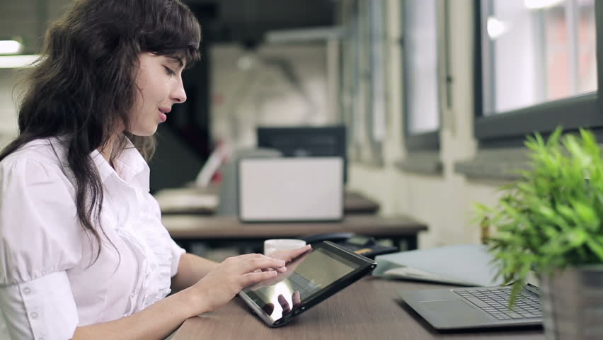 Happy businesswoman working on tablet computer in the office  | Shutterstock HD Video #2460341