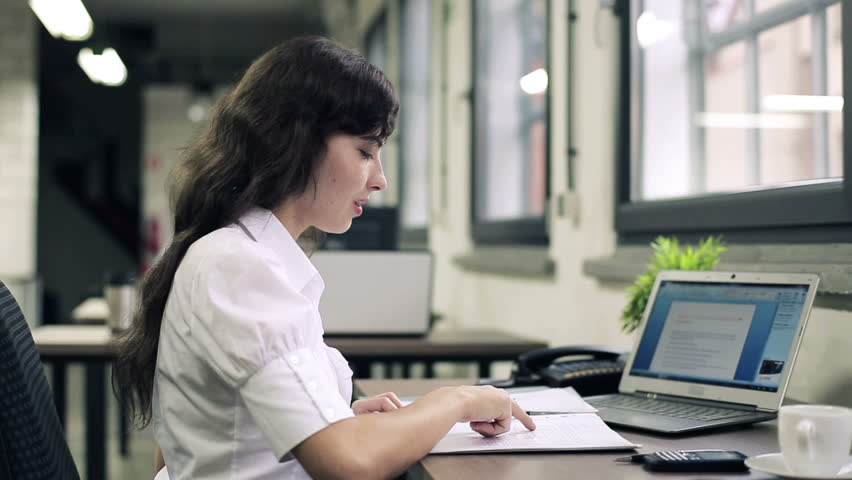 Businesswoman working with documents and laptop in the office  | Shutterstock HD Video #2460461
