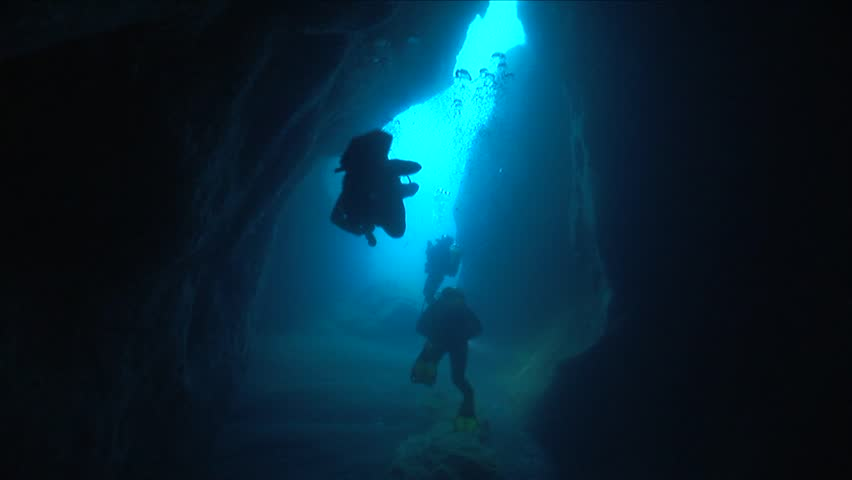 Scuba divers exploring cave underwater cave dive | Shutterstock HD Video #24613877