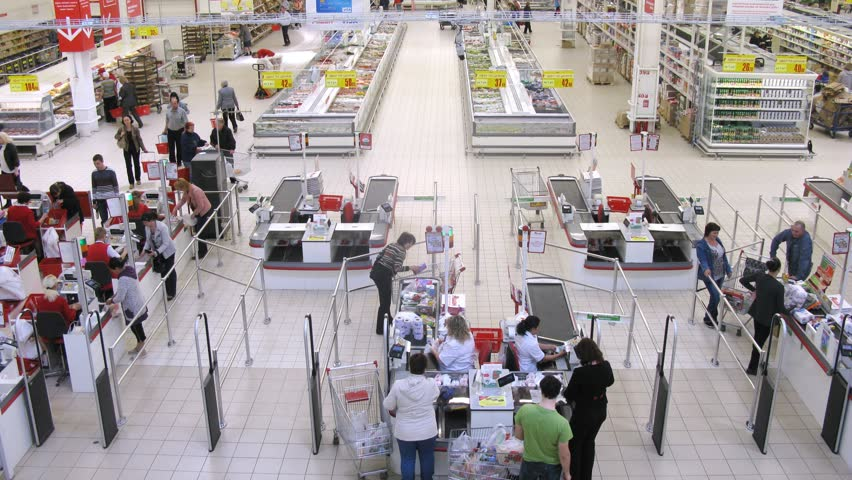 SAMARA - MAY 5: (Timelapse View) Woman pays cashier at superstore Auchan, on May 5, 2012 in Samara, Russia. There are currently 50 Auchan superstores in 19 Russian cities.