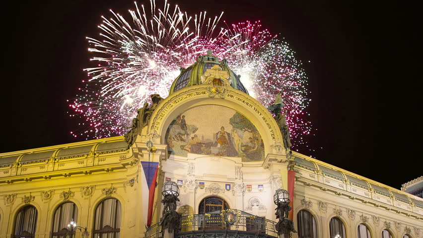 View on Municipal House (1912) in art nouveau style and holiday fireworks -- is a major landmark and concert hall in Prague, Czech Republic  #24620675