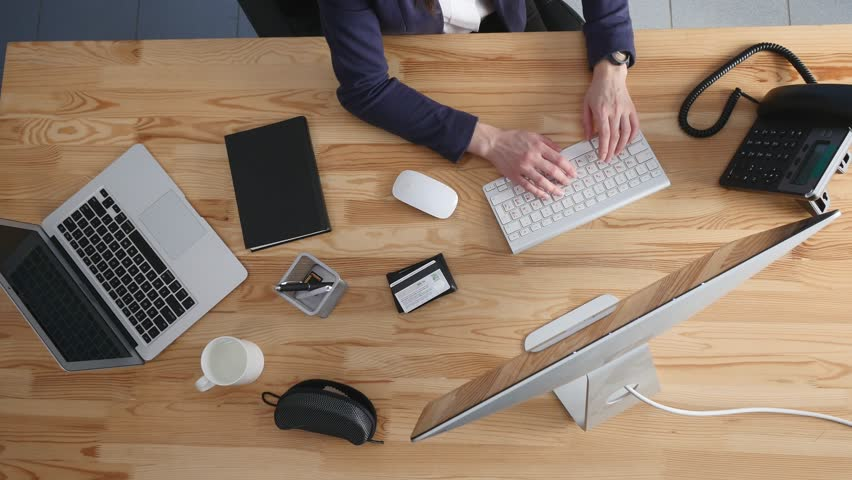 office table top. High Angle View Of An Young Brunette Working At Her Office Desk With Documents And Laptop. Businesswoman On Paperwork. Stock Footage Video 24622391 Table Top