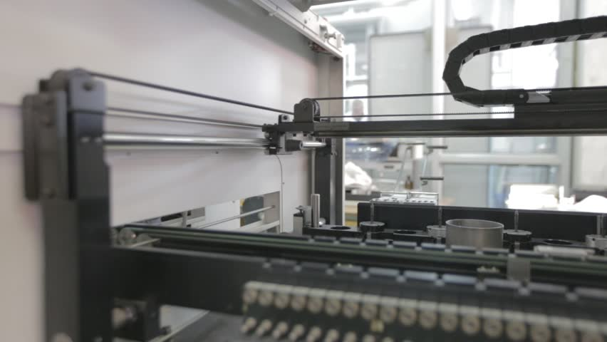 Automated Electronic circuit board production. Machine Produces Printed digital board, contract manufacturing. Manufacture of electronic chips. Camera turns right. High-tech. Industry equipment   Shutterstock HD Video #24624932
