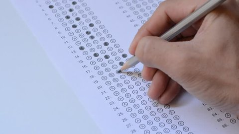 the student fills in answers on the standardized multiple choice test
