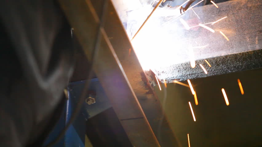 Welder is working with metal construction. Close-up of manual hand arc welding machine.   Shutterstock HD Video #2468051
