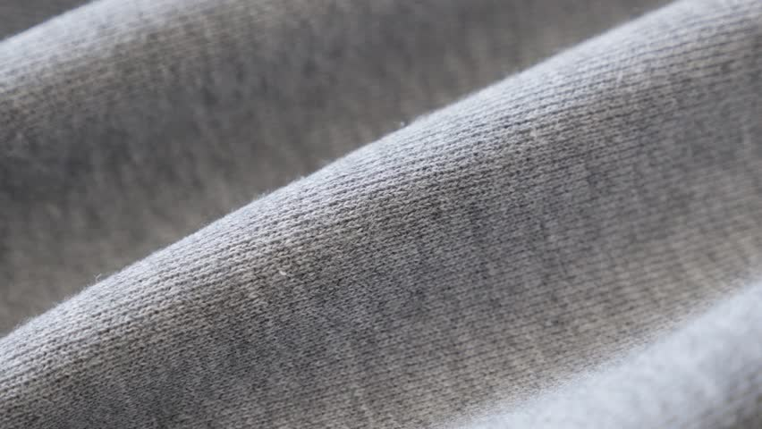 Close-up of sweating pants fabric texture and gathers slow pan 2160p 30fps UltraHD footage - Panning on fine quality cotton for sport practicing 4K 3840X2160 UHD video