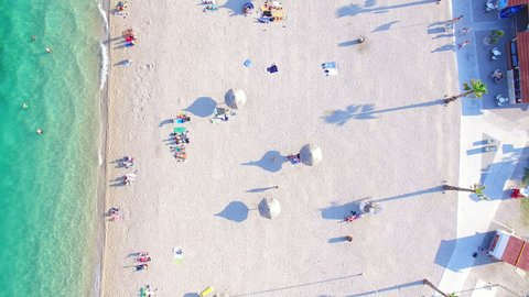 Aerial view of people sunbathing and swimming on famous white party beach of Pag island, Croatia