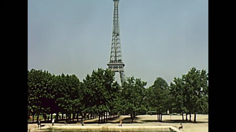 Paris Eiffel Tower panorama from Champ de Mars garden. Equestrian Statue of Marechal Joffre. Historic restored footage on 1960 in France.