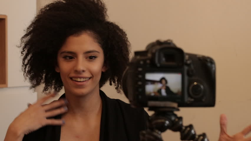 Smiling young female shooting self video | Shutterstock HD Video #24758231
