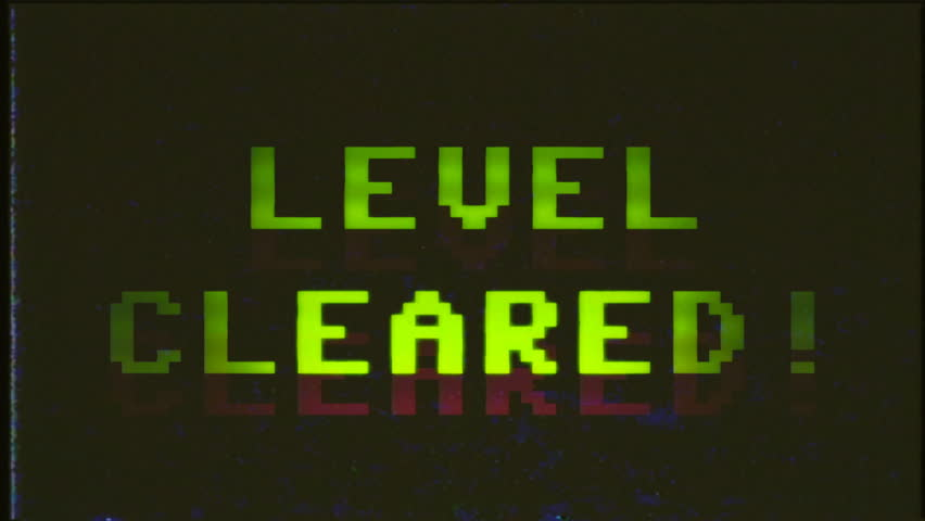 A fake VHS videogame screen with the text Level cleared. 8 bit retro style.