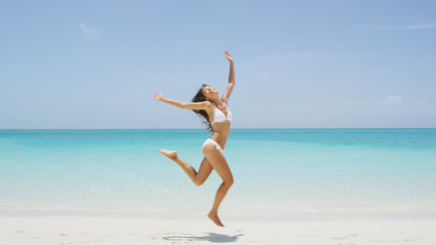 c3b01dd7dd6ce Happy joyful carefree girl jumping of joy on fun beach vacation getaway in  tropical travel holiday destination. Happiness excitement, freedom, success  in ...