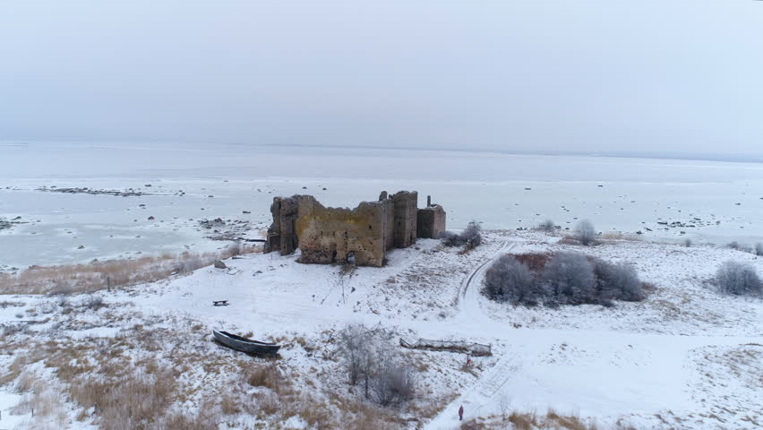 The frozen ground and sea surrounding the Toolse castle in the middle of the Lahemaa park in Estonia