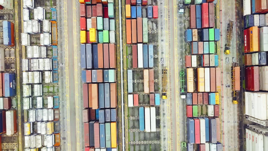 Overhead drone footage of shipping containers with transport network trucks, seamless transport routes supply chain #24828671