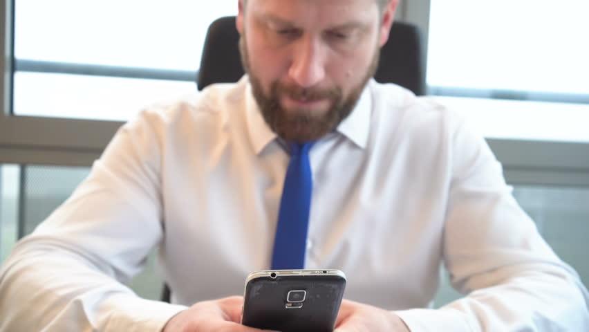 Businessman writing message sms on smartphone, sharpness on phone, close shot  | Shutterstock HD Video #24843581