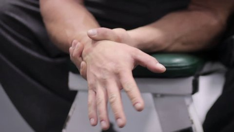 Man has carpel tunnel pain in hands after exercising wrists and forearm muscles