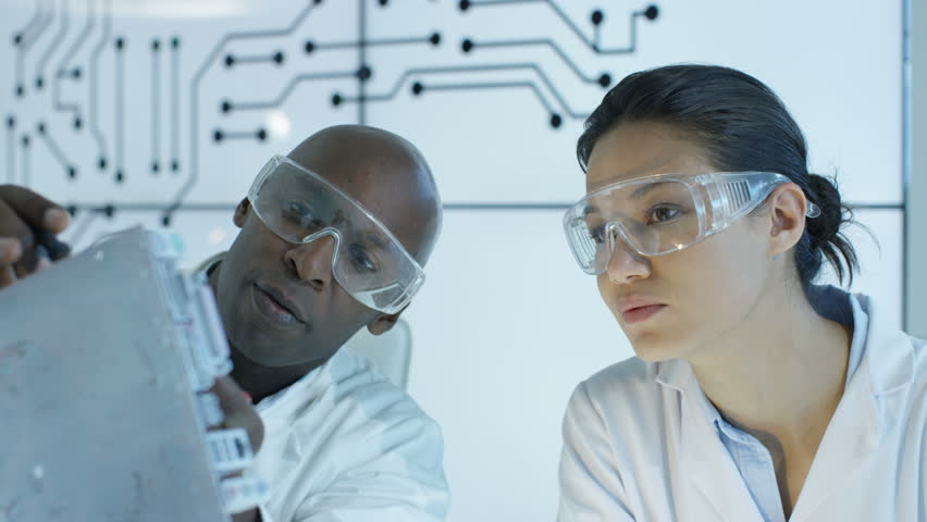 4K Electronics engineers working in lab building & testing electronic devices | Shutterstock HD Video #24884381