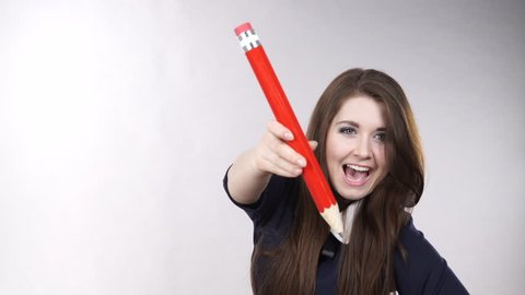 Woman smiling positive female student holds big huge red pencil. Education advertising concept 4K ProRes HQ codec