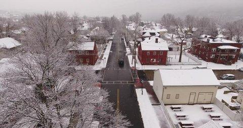 AMBRIDGE, PA - Circa March, 2017 - An aerial winter establishing shot of a small town residential neighborhood.