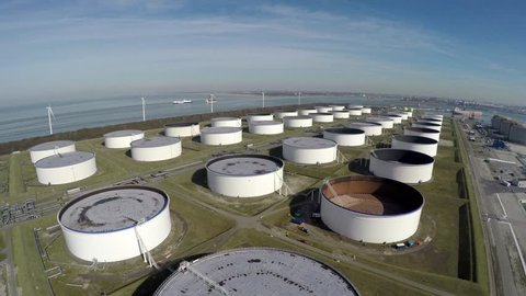 Aerial bird eye view oil depot sometimes called tank farm or oil terminal is industrial facility for storage of oil and petrochemical products ready for transport to further storage facilities 4k