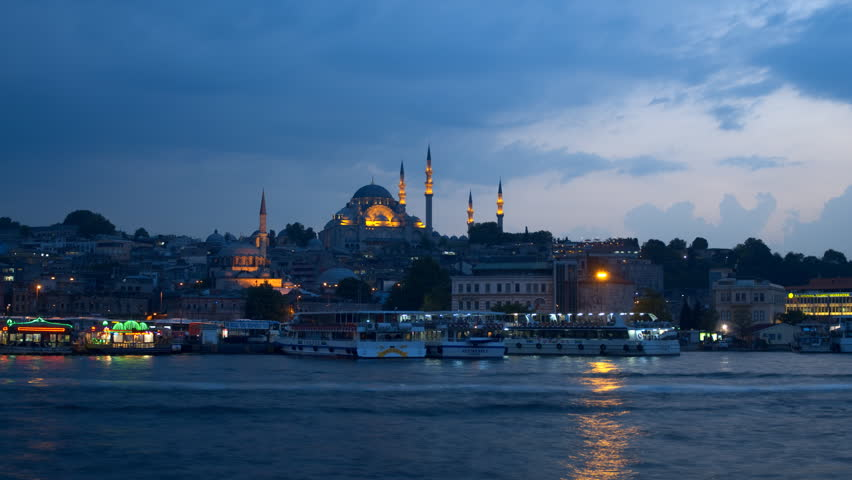 ISTANBUL, TURKEY - MAY 22: The Suleymaniye Mosque in the late evening, zooming time-lapse. Suleymaniye Mosque is the second largest mosque in Istanbul and can accommodate more then 5,000 visitors.