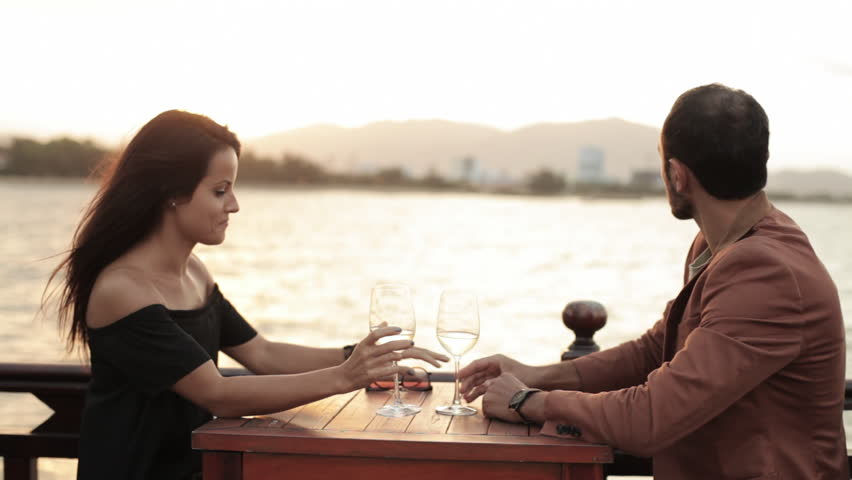 Handsome Young Man Proposes To Attractive Girlfriend On The Beach