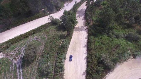 Aerial of Subaru Rally car racing along a dirt track
