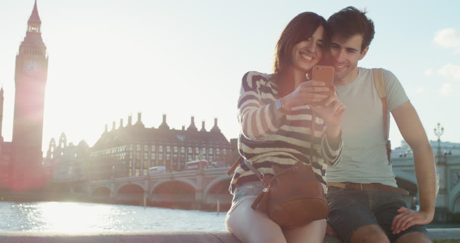 Tourist Couple holding smartphone looking at travel photo enjoying european summer vacation Big Ben London | Shutterstock HD Video #25052231