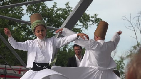 BUCHAREST - ROMANIA, May 2016:Turkish festival. Show with sufi dervish dancers,whirling dervish spins with the music, 4k